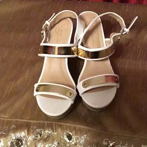 Used Report Signature White Shoes with Gold Trim